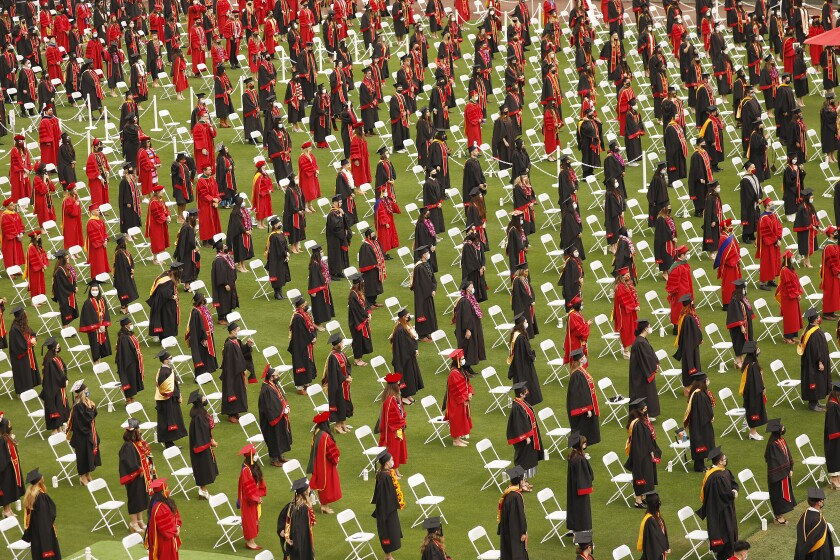USC students participate in commencement exercises at the Los Angeles Memorial Coliseum.