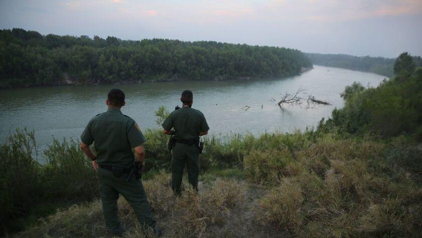 Two Border Patrol agents survey the Rio Grande in 2014. Disheartened, Cantú left the Border Patrol in 2012.