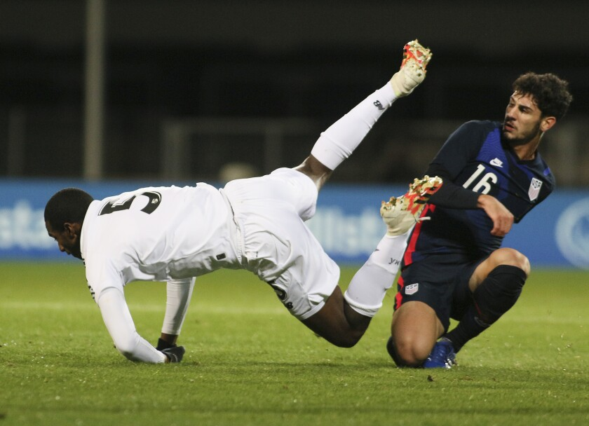 Panama's Abdiel Ayarza (5) falls as he is tackled by Johnny Cardoso of the U.S. during international friendly match Monday.