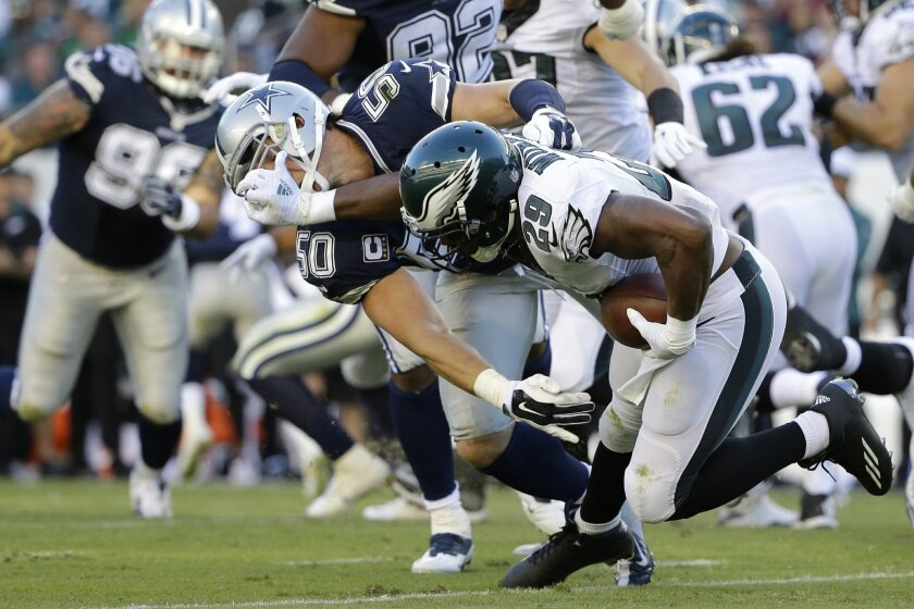 Philadelphia Eagles' DeMarco Murray (29) tries to keep Dallas Cowboys' Sean Lee (50) at bay during the first half of an NFL football game, Sunday, Sept. 20, 2015, in Philadelphia. (AP Photo/Matt Rourke)