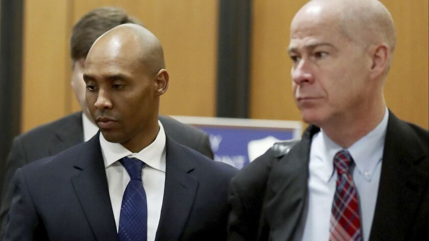 Former Minneapolis police officer Mohamed Noor, center, is accompanied by his attorneys Peter Wold,