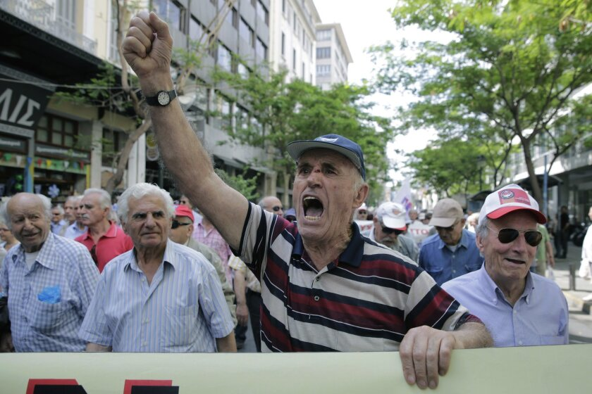 Pensioners chant anti austerity slogans during a protest in central Athens, on Wednesday, May 20, 2015. Greece's new government has been struggling to agree on reforms that creditors require in return for funds from the country's bailout needed to avoid defaulting on debts due next month.(AP Photo/Petros Giannakouris)