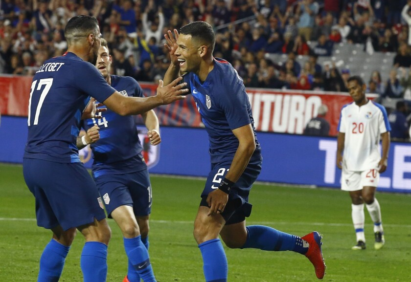 United States forward Christian Ramirez, middle, celebrates his goal with midfielder Sebastian Lletget (17) and midfielder Paul Arriola (14) as Panama midfielder Rolando Botello (20) pauses on the field during the second half of a men's international friendly soccer match Sunday, Jan. 27, 2019, in Phoenix. The United States defeated Panama 3-0.