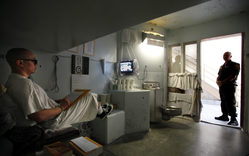 A guard watches over inmate Javier Zubiate in the isolation unit at Pelican Bay State Prison in Crescent City, Calif., in October 2012.