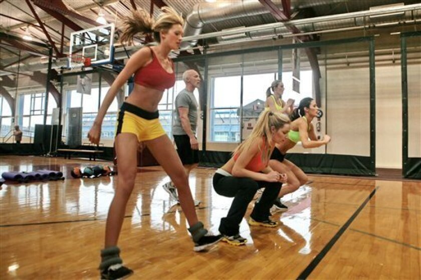 This photo taken Nov. 11, 2009 shows celebrity trainer David Kirsch, second from left, leading a workout of finalists in the Angel Boot Camp, a model search for Victoria's Secret, New York.  (AP Photo/Bebeto Matthews)