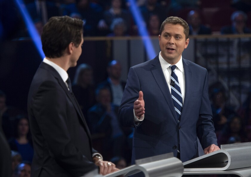Conservative leader Andrew Scheer, right, gestures towards Liberal leader Justin Trudeau as he speaks during the Federal leaders debate in Gatineau, Quebec on Monday, Oct. 7, 2019. (Sean Kilpatrick/The Canadian Press via AP)