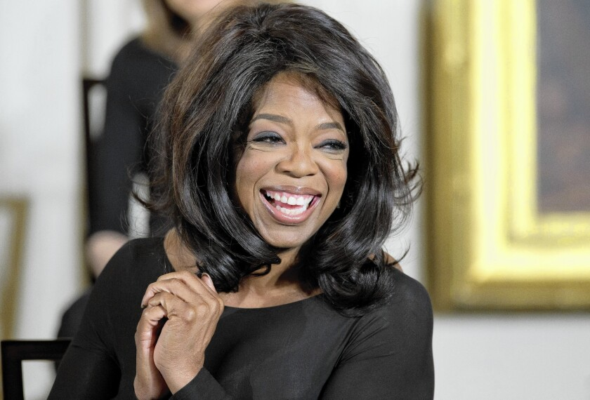 Oprah Winfrey smiles before being awarded the Presidential Medal of Freedom by President Obama at the White House. Winfrey is among the potential buyers of the Los Angeles Clippers if Donald Sterling is forced to sell the team.
