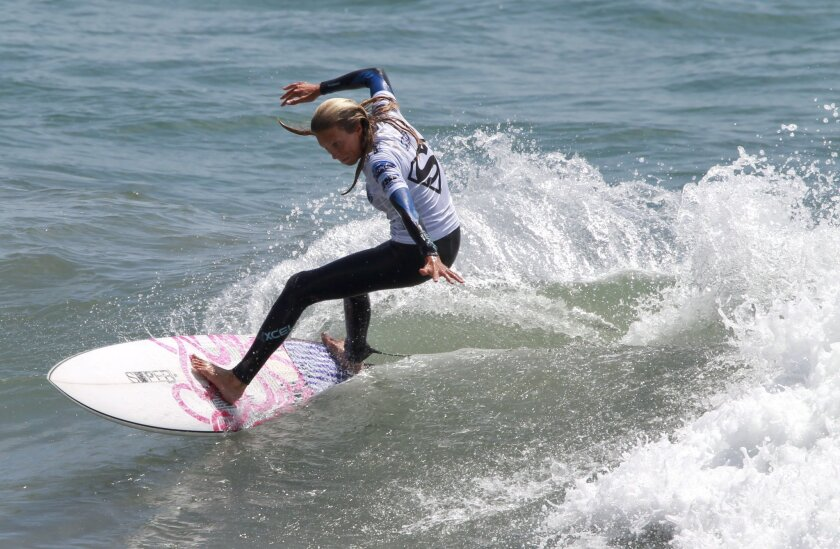 Kaleigh Gilchrist, from the U.S., competes in the Ford Supergirl Pro surf contest held at the Oceanside Pier in Oceanside on Friday