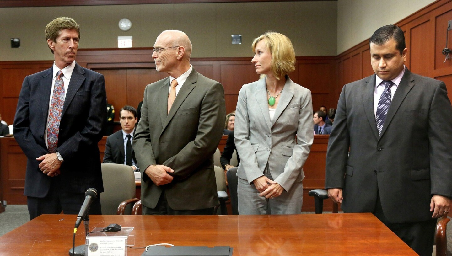 George Zimmerman looks down as the not-guilty verdict is read. From left are attorneys Mark O'Mara, Don West and Lorna Truett.