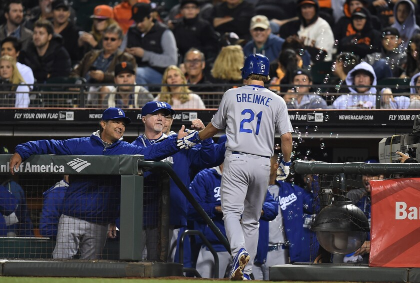 Dodgers pitcher Zack Greinke is congratulated by Manager Don Mattingly after hitting a two-run home run against the San Francisco Giants on Saturday night.