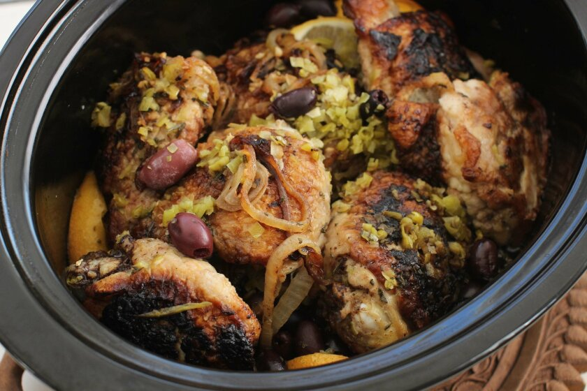 This January 25, 2016 photo shows slow cooker Greek chicken in Concord, NH.  Once this recipe is adapted for low and slow cooking, the flavors meld  perfectly and the technique is fast and simple.(AP Photo/Matthew Mead)