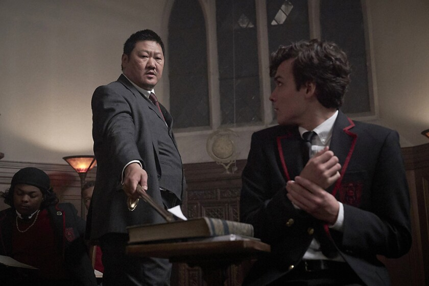 """Master Lin (Benedict Wong, left) inducts Marcus (Benjamin Wadsworth) into a private high school specializing in assassination in Syfy's """"Deadly Class."""""""