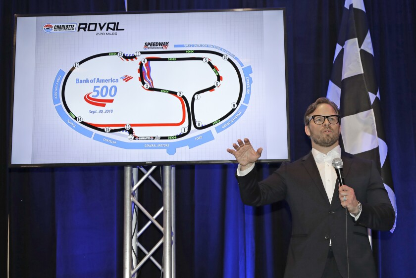 FILE - Marcus Smith, CEO of Speedway Motorsports, talks about the upcoming Bank of America 500 NASCAR Cup series auto race on the new road course during a news conference at Charlotte Motor Speedway in Concord, N.C., in this Monday, Jan. 22, 2018, file photo. NASCAR wanted new energy and ideas this season and Marcus Smith has been pivotal in helping the sport deliver. (AP Photo/Chuck Burton, File)