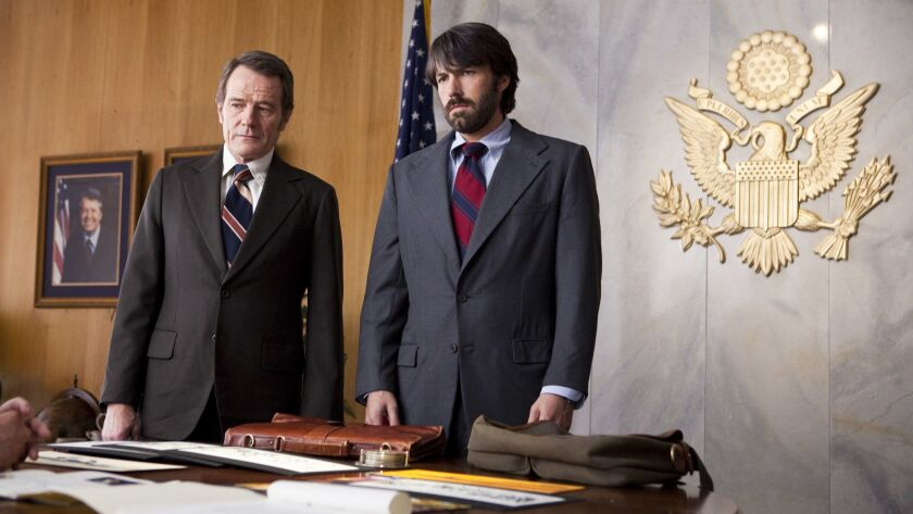 "(L–r) BRYAN CRANSTON as Jack O'Donnell and BEN AFFLECK as Tony Mendez in the movie ""ARGO,"" a present"