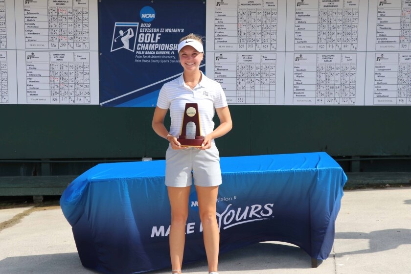 Jaime Jacob of Cal State San Marcos poses with her trophy after winning the Div. II national championship.