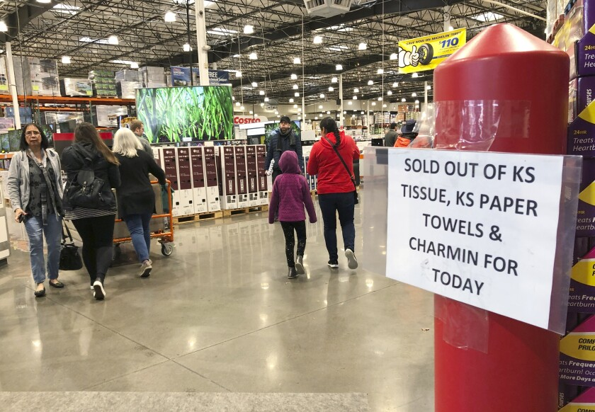 Shoppers visit a Costco Wholesale in Tigard, Ore., on Saturday.