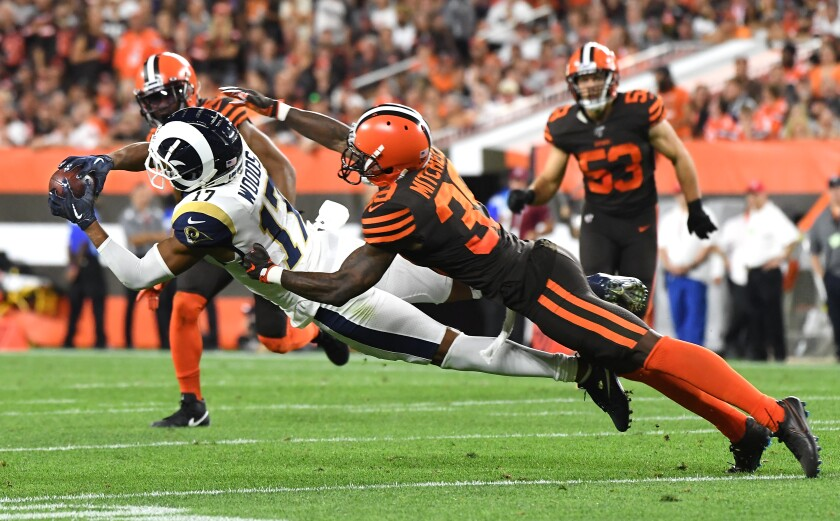 Rams wide receiver Robert Woods makes a diving catch in front of Browns cornerback Terrance Mitchell.