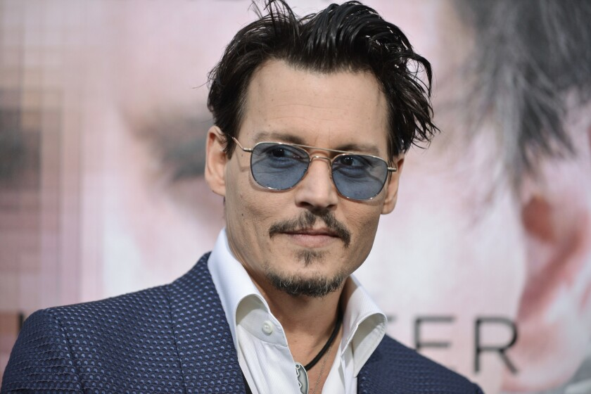 """Johnny Depp at the Los Angeles premiere of """"Transcendence."""""""