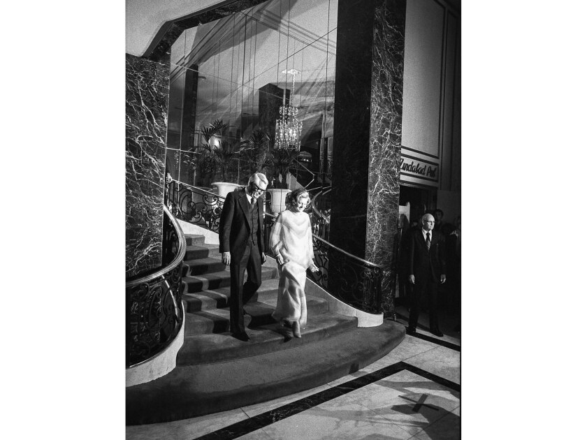 May 5, 1976: Betty Ford, on a brief tour of the state, descends the mirrored staircase of the Beverly Wilshire, accompanied by actor Cary Grant, on her way to a news conference in the lobby.