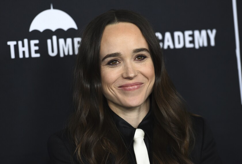 """FILE - Elliot Page arrives at the Los Angeles premiere of """"The Umbrella Academy"""" on Feb. 12, 2019. Page, the Oscar-nominated actor of """"Juno"""", """"Inception"""" and """"The Umbrella Academy"""" came out as transgender on Tuesday in an announcement greeted as a watershed moment for the trans community in Hollywood. The 33-year-old actor from Nova Scotia said his decision came after a long journey and with much support from the LGBTQ community. (Photo by Jordan Strauss/Invision/AP, File)"""