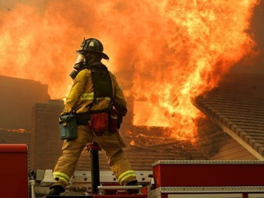 How can I help prevent my home from burning down in a wildfire?