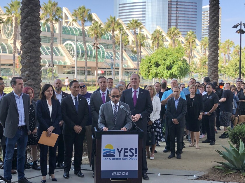 Supporters of a proposed hotel tax measure on next March's ballot gather downtown to launch the Yes! For A Better San Diego campaign. At the podium is Deacon Jim Vargas, CEO of Father Joe's Villages.