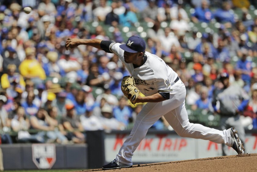 Milwaukee Brewers starting pitcher Junior Guerra throws during the first inning of a baseball game against the Chicago Cubs Thursday, May 19, 2016, in Milwaukee. (AP Photo/Morry Gash)