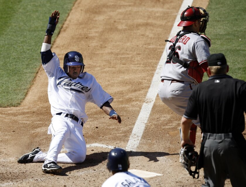 Swift Padres rookie Luis Durango scores on a sacrifice fly by Tony Gwynn. (K.C. Alfred / Union-Tribune)