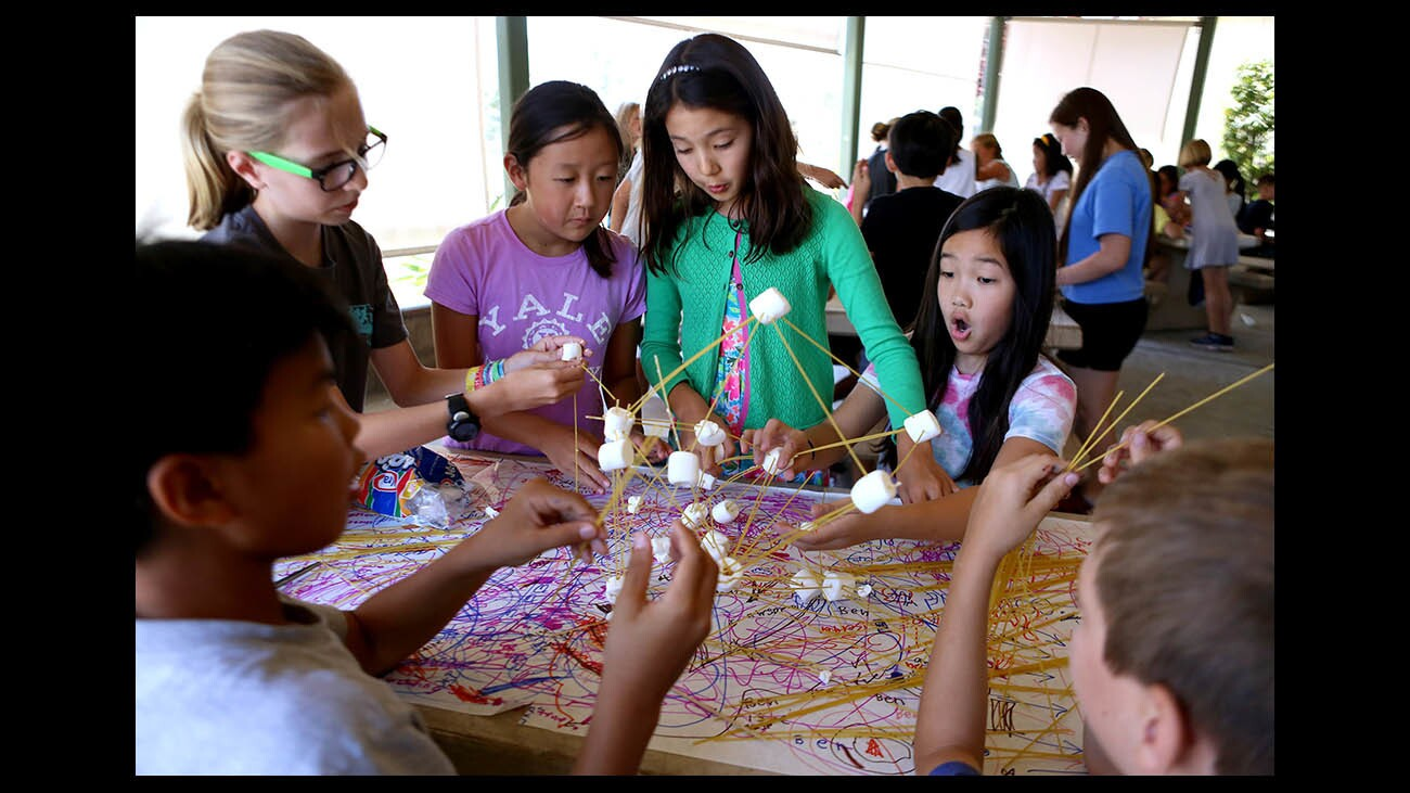 La Canada Unified School District fourth- to sixth-graders build a pasta and marshmallow tower at the Science National Honors Society Camp, at La Canada Elementary School, in La Canada Flintridge on Thursday, June 28, 2018. The towers where then subjected to simulated earthquakes to show which structures were designed with strength.