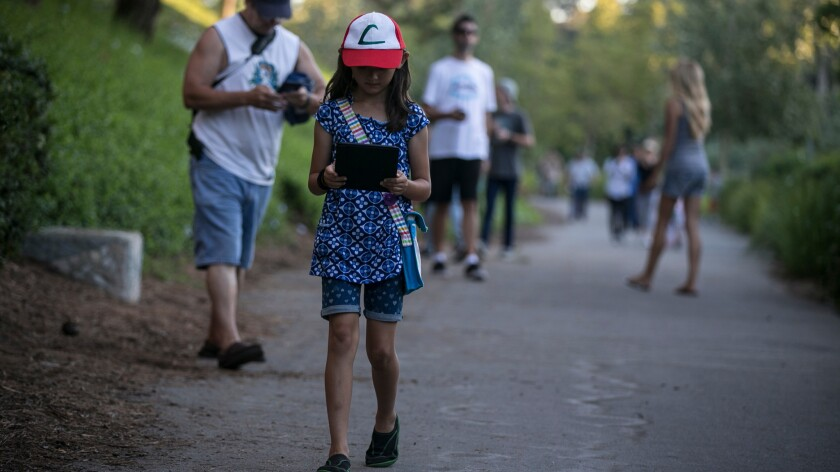 An 8-year-old plays Pokemon Go in Mission Viejo. The American Academy of Pediatrics advises parents to limit kids' time with digital devices and TV.