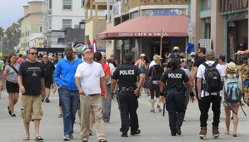 LAPD officers patrol the Venice Boardwalk.