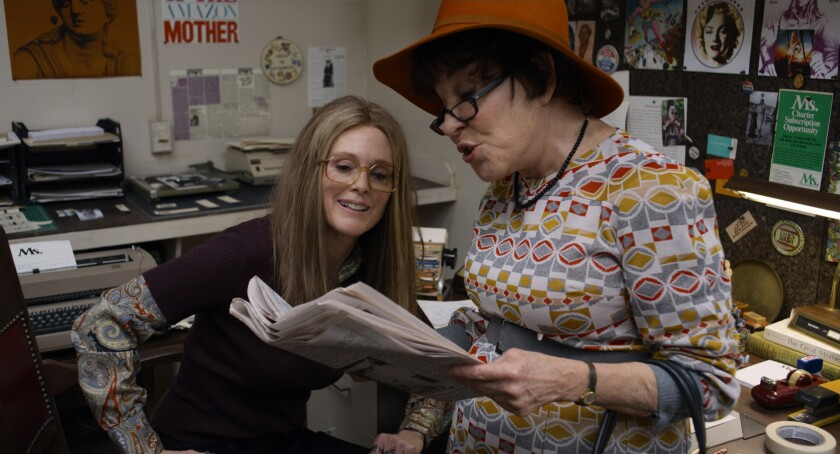 """This image released by LD Entertainment and Roadside Attractions shows Julianne Moore as Gloria Steinem, left, and Bette Midler as Bella Abzug in a scene from """"The Glorias."""" (LD Entertainment and Roadside Attractions via AP)"""