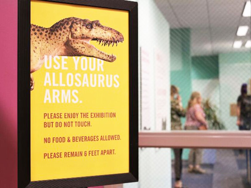"A poster of a dinosaur that reads ""Use your allosaurus arms"" and lists museum restrictions."