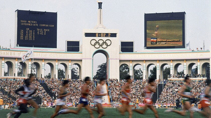 Runners compete in the men's 5,000 meters during the 1984 Summer Olympics at the Los Angeles Coliseum.
