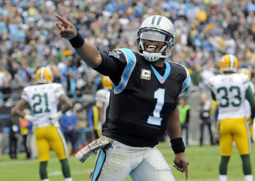 Carolina Panthers' Cam Newton (1) celebrates his touchdown pass against the Green Bay Packers in the first half of an NFL football game in Charlotte, N.C., Sunday, Nov. 8, 2015. (AP Photo/Mike McCarn)