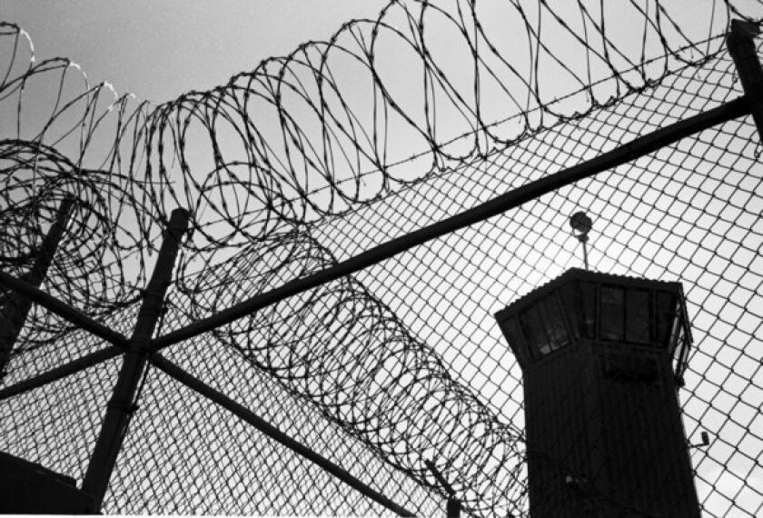 California officials reach deal to seek compliance with prison order