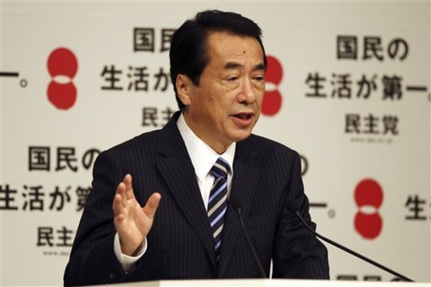 Japanese Prime Minister Naoto Kan speaks at a press conference after he was re-elected as president of the Democratic Party of Japan during the party convention in Tokyo Tuesday, Sept. 14, 2010. Kan was re-elected president of the party on Tuesday, surviving a stiff challenge from a veteran powerbr