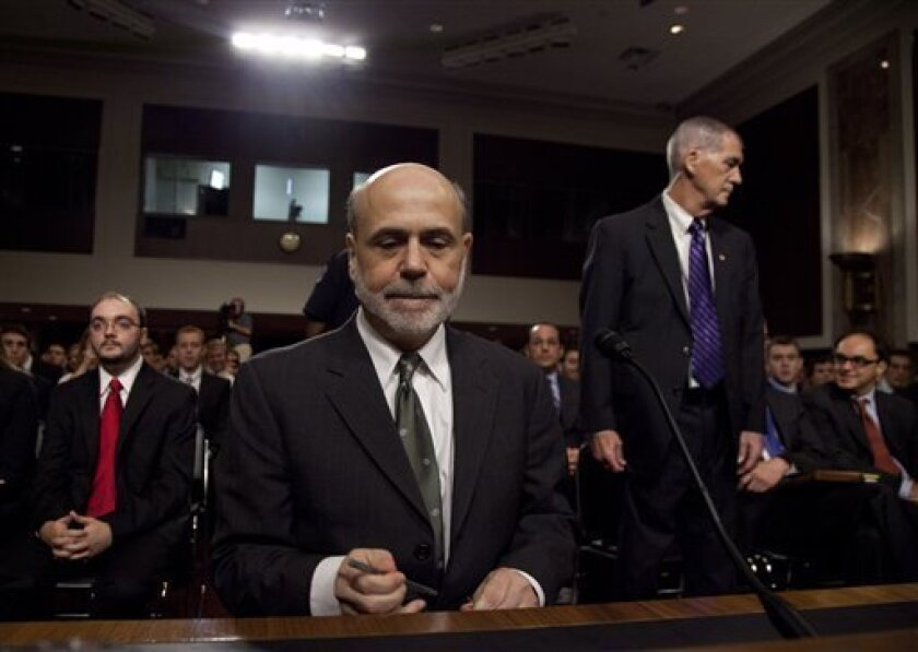 Federal Reserve Board Chairman Ben Bernanke pauses as he arrives to give a  semiannual report to the Senate Banking Committee,  Tuesday, July 17, 2012, on Capitol Hill in Washington. Bernanke's testimony comes as job growth has slumped, manufacturing has weakened and consumers have grown more cauti