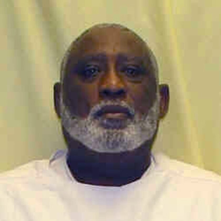 This undated photo provided by the Ohio Department of Rehabilitation and Correction shows a booking photo of James Frazier. The Ohio Supreme Court has set an execution date for the condemned killer over the objection of two justices who question establishing dates when the state doesn't have any le