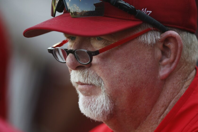 New Mexico coach Ray Birmingham watches the game from the dugout during an NCAA college regional baseball game against Texas Tech, Saturday, June 4, 2016, in Lubbock, Texas. (Brad Tollefson/Lubbock Avalanche-Journal via AP) ALL LOCAL TELEVISION OUT; MANDATORY CREDIT