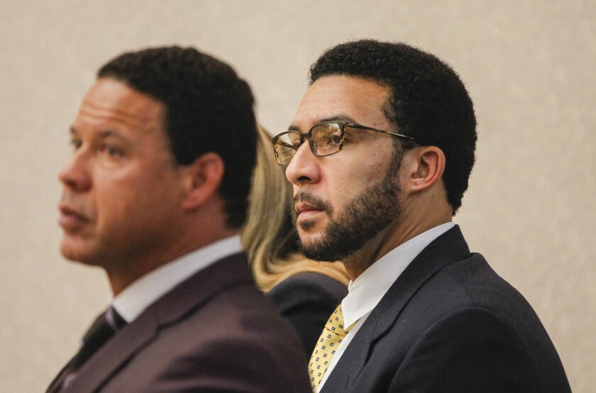 Kellen Winslow II (right) appears in court along with his defense team Brian Watkins (left) on June 11, during verdict readings at Vista Superior Court. The jury deadlocked on eight counts, and Winslow will be retried. A new attorney has stepped in for Watkins, who is said to be unavailable for retrial, now set for Oct. 16.