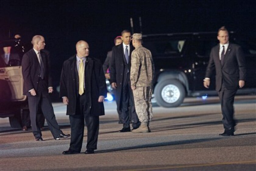 RETRANSMITTED FOR IMPROVED QUALITY - President Barack Obama, left is greeted by Air Force Col. Manson Morris, right, during his arrival at Dover Air Force Base, Del., Thursday, Oct. 29, 2009.(AP Photo/Pablo Martinez Monsivais)