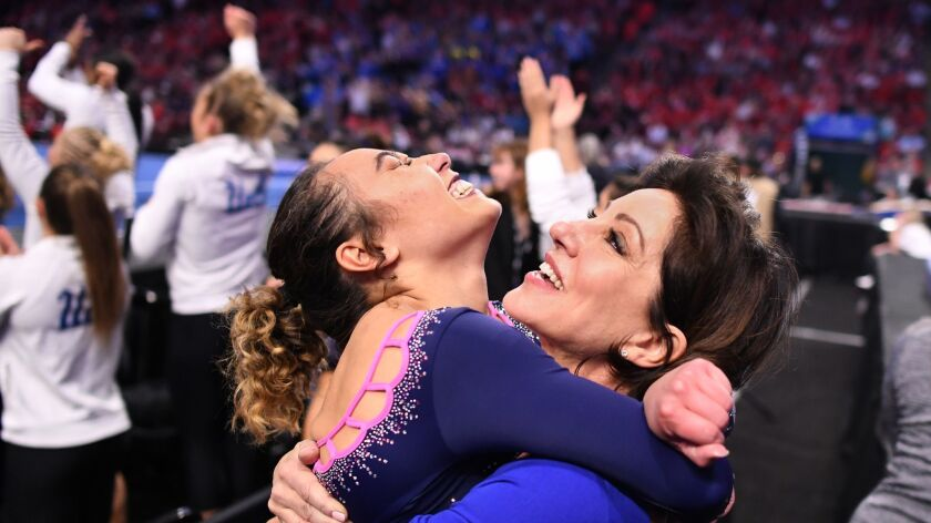Katelyn Ohashi jumps into the arms of coach Valorie Kondos Field after her perfect score on the floor exercise during the Pac-12 championship in Utah.