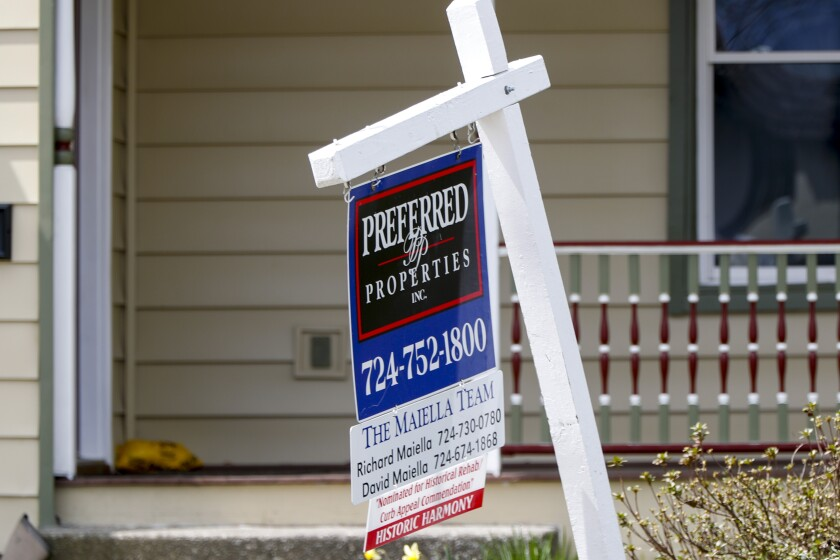 This April 16, 2020 photo shows a real estate company sign marking a home for sale in Harmony, Pa.