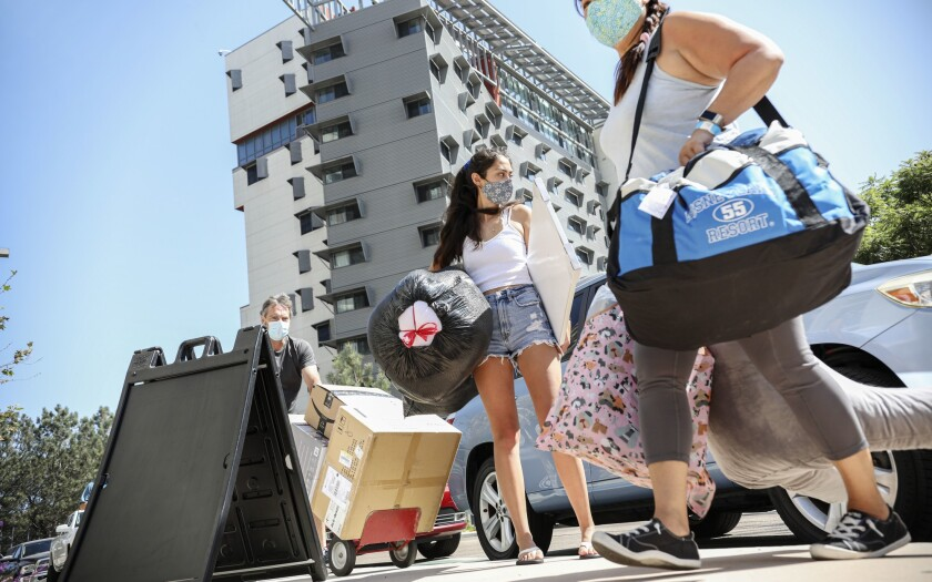 Holly Fleurbaaig moves her belongings into the dormitories at UC San Diego.