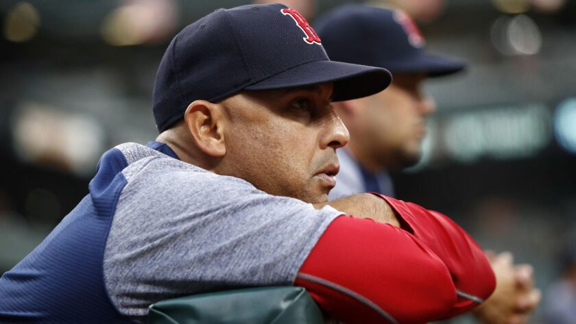 Boston Red Sox manager Alex Cora leans against the dugout rail during the second inning against the Baltimore Orioles on July 24, 2018 in Baltimore.