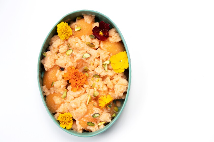Ripe melons are made into a rosewater-tinged granita, then served over more melons with pistachios and edible flowers.