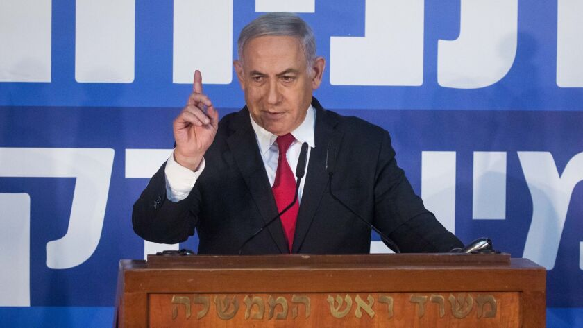 Israeli Prime Minister Benjamin Netanyahu gives a statement to reporters Feb. 28 on the attorney general's decision to indict him on charges of bribery, fraud and breach of trust, pending a hearing.