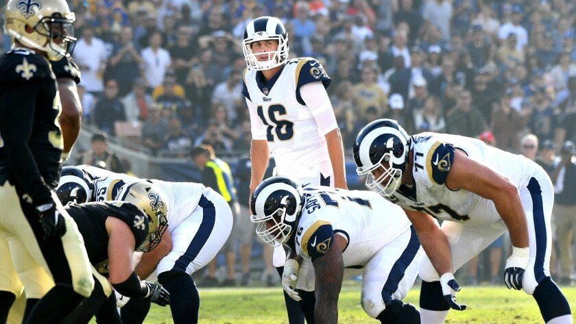 Rams quarterback Jared Goff surveys the Saints defense before calling a play at the line of scrimmage on Sunday.
