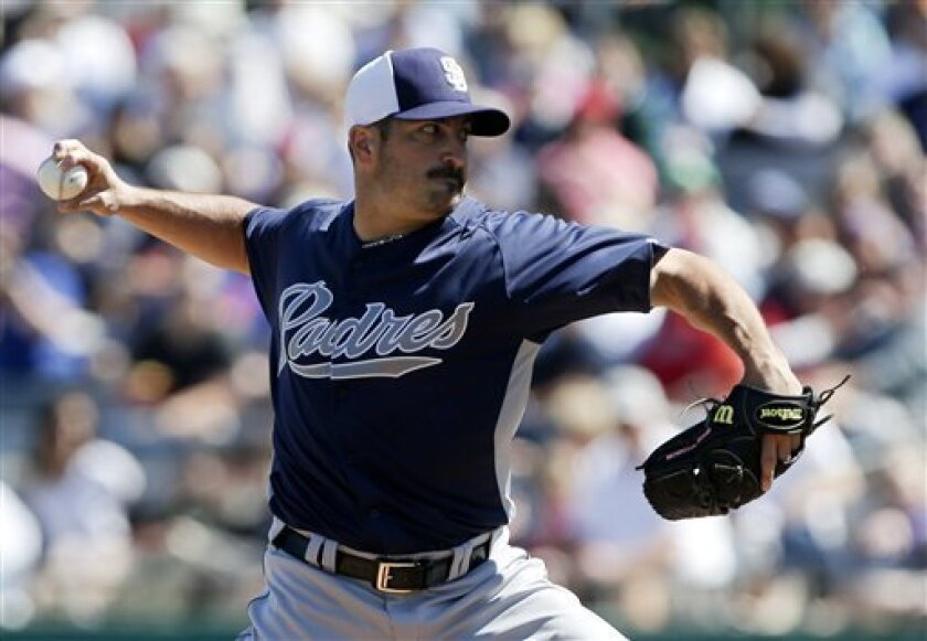 San Diego Padres starting pitcher Jason Marquis throws to the Chicago Cubs during the first inning of a spring training baseball game in Mesa, Ariz. Sunday, March 10, 2013. (AP Photo/Chris Carlson)